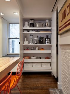I love this idea.  especially on the end cabinet where the refridgerator is built in instead of the utilities closet.