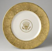 Series of service plates for Dwight David Eisenhower (President 1953-1961)--State Service Plate/Made in New Castle, PA, c.1955--Made by Castleton China, subsidiary of Shenango Pottery Company, New Castle, PA, active 1939-1976--Mamie Eisenhower ordered 120 Castleton service plates for use with the Truman state china service. Porcelain with gilt decoration. Diameter: 11 5/8 inches (29.5 cm)