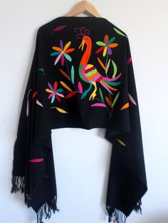 Feminine black shawl, hand embroidered by Otomi hands from Mexico. 100% Cotton. Threads naturally dyed. The process to make this shawl is long, slow