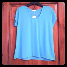 Blue suit shell top Never been worn! This beautiful blue shell is perfect under suit jackets for the office. Soprano Tops Blouses