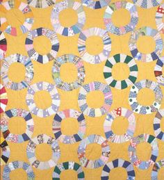 This block pattern quilt, sewn by Kalley Green in the 1930s or '40s, includes cotton scraps and pieces of feed sacks in its hand-stitched top.