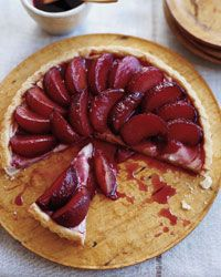 """Poached Plum Tart Recipe on Food & Wine Nina Planck believes in eating """"real"""" food in its purest, least-processed state, including unpasteurized whole milk with a thick layer of cream on top. She makes this elegant, juicy custard tart with fresh butter, eggs, milk and—when they're available locally—sweet, firm Green Gage plums."""