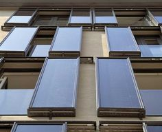 Using movable solar panels on building facades as shutters.