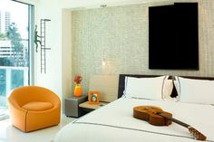 Bedroom : Distinct Masculine Bedroom Vibe Green Color Texture Shade Background White Bedding Set Cushions Orange Armchair Flower Vase Cream Chair Mini Wall Lamp White Wall Color High Gloss Flooring Large Glass Windows Guitar On The Bed 50 Astonishingly Elegant Bedrooms With A Different And Attractive Masculine Sensation Elegant Masculine Bedroom. Masculine Bedrooms. Masculine Men Bedroom.