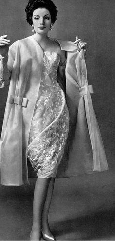 1958 Model in pale pink silk embroidered dress worn under sheer pink silk-organdy coat by Jean Dessès
