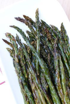 Roasted Asparagus is made by coating fresh asparagus with olive oil, salt, and pepper, and then roasting it in the oven until it is perfectly tender and golden brown.  You will never steam asparagus again!