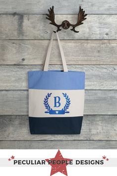 """A personalized carryall for a baker. Cute, useful and one of a kind. Whether a monogrammed gift for your favorite baker, or as a shopping tote for yourself; with these roomy totes, you can't go wrong. Fully customized with your choice of tote color and decoration finish color/texture. Pair it up with a coordinating apron for custom gift set! TRI-COLOR TOTE: -Size: 15""""W x 15""""H x 3""""D -Squared Off, Gusset Bottom -100% cotton -12oz heavy canvas -20"""" natural web handles with a 8"""" drop -11L CARE…"""