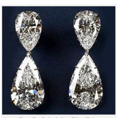 Harry Winston 60 CT Diamond Earrings in Platinum