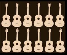wooden guitars by the dozen Maybe I can use these to make a mobile? Guitar Decorations, Christmas Decorations, Make A Mobile, Art Shed, Rock Star Party, Wood Cutouts, Home Wedding, Wedding Decor, Nature Crafts