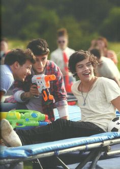 Harry:guys see that girl over there she's really fit. Louis get her attention Louis: no you like her you get her attention Harry: I dont want to please  zayn: I'll do it *squirts her with water gun