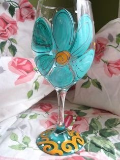 Flower painted on wine glass