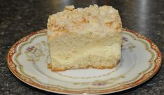 Cream Cheese Coffee Cake with Crumble Topping. Filling: 16oz cream cheese (soft), 100g white sugar, 1/2 teaspoon vanilla, 1 large egg. Cake: 375g AP flour, 1 teaspoon baking powder, 1/2 teaspoon baking soda, 1/2 teaspoon salt, 4oz butter (soft), 200g sugar, 4 large eggs, 1 teaspoon pure vanilla extract, 230g sour cream. crumb topping: 50g white sugar, 32g AP flour, 1.5oz butter (cold).