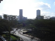 A highway with the background of the central business district of the beautiful city of Nairobi, Kenya.