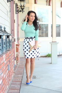 Mint top with polka dots skirt - navy belt - statement necklace - blue pumps - fold over clutch - StylishPetite.com