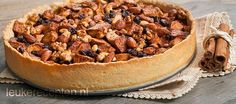 Makkelijk recept voor een goed gevulde taart met appel, verschillende soorten noten en krenten
