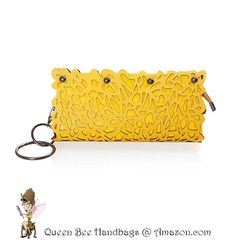SUNSHINE YELLOW - This trend setting, day to evening, women's clutch purse shouts fashionista with its unique, laser cut floral design, dark silver hardware, and an alternate chain shoulder strap option. Special feature wristlet bangle. $24.99 on Amazon.com. #purses #clutches #lasercut