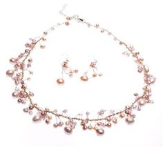 Oi! Pink Fresh Water Pearl and Crystal on Silk Necklace and Earrings Set Oi!, http://www.amazon.co.uk/dp/B00CIRK3KU/ref=cm_sw_r_pi_dp_M65otb0Y469HB