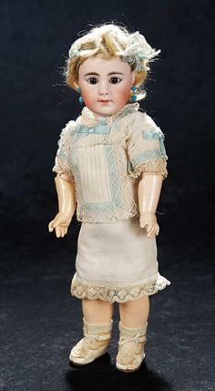 Theriault's. Rare and all-original German bisque closed mouth child,929,by Simon and Halbig. In an all-original un-played with condition,wearing factory chemise with aqua silk ribbons and lace,earrings,cream kidskin shoes with silk rosettes. Upcoming at Theriault's Stein am Rhein auction on March 29th and 30th, 2014 in Naples Florida. For more info please visit: www.theriaults.com/