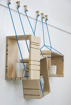 Parasite shelf by Johanna Landin - The system consists of plywood boxes suspended from wooden hooks on blue ropes, which pass through grooves in the outside of each box. Inspire Me Home Decor, Deco Design, Wood Design, Diy Interior, Interior Design, Wood Furniture, Furniture Design, Muebles Art Deco, Plywood Boxes