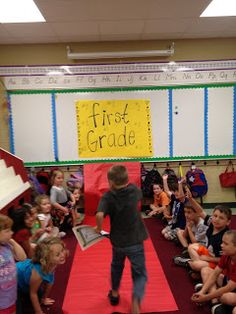 """last day of class"" -elementary school - walk the red carpet to the next grade."