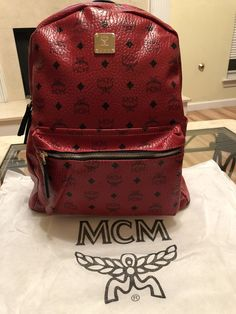 152b35ef131 Medium red and black MCM Backpack.