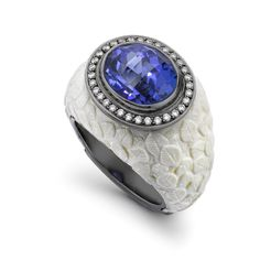 This Theo Fennell ring is skilfully carved from the tusks of a long-extinct Mammoth. The 6.52ct tanzanite, set in white gold, is framed by 0.22ct of diamonds.