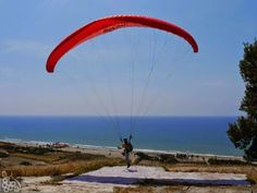 #Paragliding at #Kourion... From the beach, you will often see experts riding the thermals at Kourion (aka #Curium). I was hoping to spot the #RedArrows winter training when I captured this German pilot spreading out his paraglider and taking his leap of faith. He made it look so easy! (And just as we were about to give up, the Red Arrows roared into the sky!) You can book a tandem flight from www.cyprusflyadventures.com. Post and photo: Nikki at www.pissouribay.com.