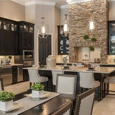 Black cabinets and natural stone ... if you're tired of white kitchens | by Masterpiece Design Group |