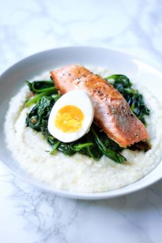 A savory meal that is for breakfast brunch and dinner this Salmon and Grits with Garlicky Greens & Boiled Eggs recipe is very versatile! It's creamy cheesy and savory so this recipe is a great way to break from the traditional Southern style grits. Egg Recipes, Salmon Recipes, Fish Recipes, Seafood Recipes, Great Recipes, Healthy Recipes, Healthy Meals, Healthy Food, Favorite Recipes
