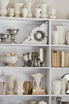 white pottery collection, books turned backwards