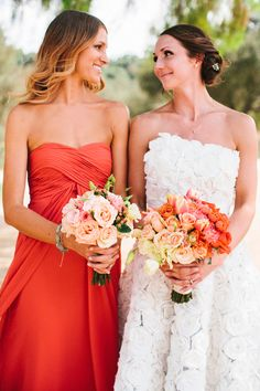 Gorgeous deep tangerine / coral bridesmaid dress, and oh, those flowers!
