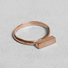 Petit Sesame | Rose gold-plated petit lingot ring | Designed by Petit sesame | $12.00 | Rose gold plated 925 silver ring adorned with a thin brushed bar