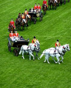 Queen Elizabeth and Prince Philip (in first carriage) are followed by others as they arrive at Royal Ascot.