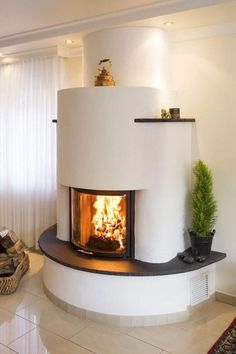 The semicircular fireplace insert is from Spartherm. The base can be used as a seat . The semicircular fireplace insert is from Spartherm. The base can be used as a seat and, like the l Home Fireplace, Living Room With Fireplace, Fireplace Design, Living Room Decor, Bedroom Decor, Fireplace Ideas, Fireplace Inserts, Design Case, Interior Design Living Room