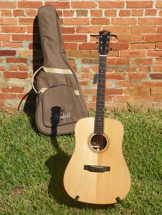 Retail $1850 Street $1300OVERVIEWSolid Indian rosewood back and sides with an African ebony fingerboard.Beautifully  executed, the Bedell Performance TB-28-G Dreadnought Acoustic Guitar is  a classic Dreadnought. The Solid Indian rosewood back and sides  accentuate the warm bass tones, while the Solid Alaskan Sitka spruce top  adds clarity and balance. The African ebony fingerboard and bridge  enhance the definition of notes and ease of playing.With  Bedell guitars each section of wood...
