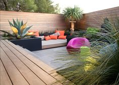 Inbuilt decking seats and outdoor chill out zone - love this! Plus add in a fire pit