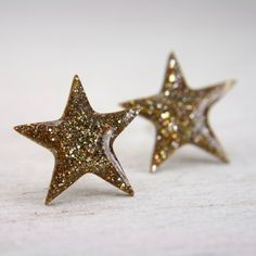 star post earrings in sparkly gold galaxy earrings glitter stud sterling silver jewelry. $20.00, via Etsy.