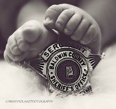 Sheriffs office badge and baby feet. Super adorable.