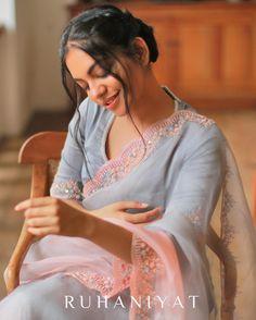 Image may contain: 1 person, sitting, text that says 'RUHANIYAT' Silk Saree Blouse Designs, Blouse Neck Designs, Blouse Patterns, Fancy Sarees, Party Wear Sarees, Indian Bridal Sarees, Saree Trends, Sari Dress, Organza Saree