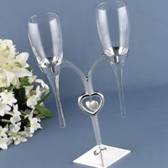 Add a bit of unique to your wedding party's table with these raindrop flutes and their elegant holder.  Toast your new life together with class and elegance.  http://www.favorfavor.com/page/FF/PROD/HBH32429