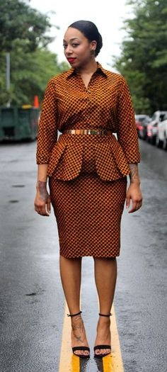Cobra - Pencil Skirt Shirt Set - Dutch wax is an understated fabric. It has a sheen that is very appropriate for the office and adds a cultural flare. The petal peplum is appealing and concealing. African Dresses For Women, African Print Dresses, African Attire, African Wear, African Fashion Dresses, African Women, African Prints, Ankara Fashion, African Style