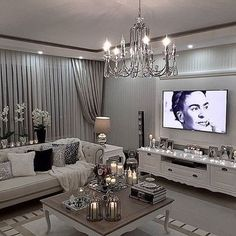We could really glam up our family room with curtains, glass, and a slip cover.