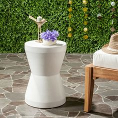 Brighten up a poolside or living room ensemble with this ivory concrete indoor-outdoor accent table. 17 high x 12 wide x 12 deep. Torre indoor-outdoor accent table from Safavieh. Outdoor End Tables, Patio Tables, Patio Sets, Outdoor Stools, Patio Dining, Dining Tables, Concrete Stool, Drum Table, Table Saw