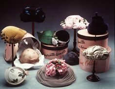 This image shows a selection of hats from Powerhouse Museum Sydney Australia collection along with hat boxes and display stands. These hats were made between 1900s and the 1960s and all but one were made in Australia.