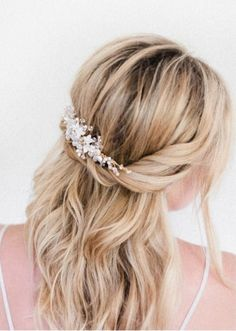 Adding a little baby's breath to your wedding hair is one of the hottest things you can do for 2015. And it doesn't matter if it's up, down or swept to one side, these tiny little flowers will suit any style. Group them together for a statement or distribute them through a plait. Either way, it'll be super pretty!