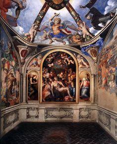 Vista da capela de Eleonora de Toledo 1540-1545 Agnolo Bronzino - Palazzo Vecchio, Florença  Esta perspectiva mostra o retábulo e os afrescos da capela de Eleonora de Toledo no Palazzo Vecchio, em Florença.  Em 1540, logo após se casar com Eleonora de Toledo, Cosimo de Medici mudou  do Palazzo Medici  para o Palazzo della Signoria, proclamando publicamente seu domínio sobre todas as instituições cívicas.  Cosimo reformou o prédio para acomodar sua família em expansão e encomendou  decorações…