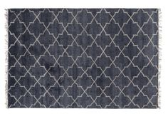 Crafted of wool with a dynamic allover design, this rug enriches any space with incredible texture and pattern. We recommend a rug pad to extend the life of the rug and keep it securely in place.