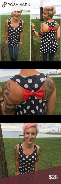 Polka Dot Bow Tank [Heather Navy & Red] Adorable, fabulous, and ready to slay day or night. Polka dot tank top with bow racerback. 60% polyester/ 35% rayon/ 5% spandex. Made in USA. Available in women's small, medium, or large. CLE Threads Tops Tank Tops