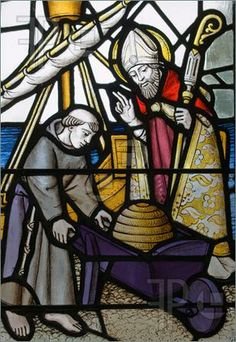 Photo of A Victorian stained glass window depicting Saint David blessing a hive of bees as they are about to be shipped to Ireland by Domhnog.
