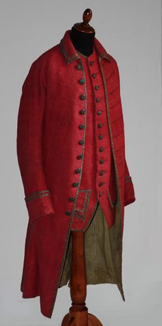 Coat and waistcoat, Germany, mid 18th century. Red ribbed wool decorated with gold metallic braid, cream wool lining.